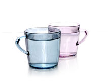 Color water. Water in pink and blue color cups Royalty Free Stock Image