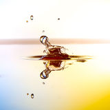Color waterdrops collide each other Royalty Free Stock Photography