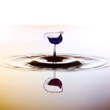 Color waterdrops collide each other Royalty Free Stock Photos