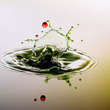 Color waterdrops collide each other. Splashing water drops on color background.Color waterdrops collide each other Stock Image