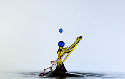 Color waterdrops collide each other,like a woman. Royalty Free Stock Photography