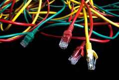 Color wire lan of internet network connection. On black background technology royalty free stock photography