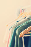 Color Woman Clothes on Open Hanger. Close up of Color Woman Clothes on Open Hanger Royalty Free Stock Photo