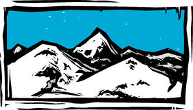 Color Woodcut Mountain. Woodcut style mountain range on a clear blue day Royalty Free Stock Images