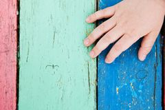 Color wooden boards with child hand Stock Image