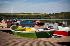 Color Wooden Boats with Paddles in a Lake Royalty Free Stock Photos