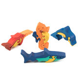 Color wooden fish toys Stock Photos