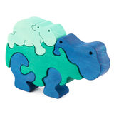 Color wooden hippo toy. Color wooden creative hippo puzzle toy on white stock photos