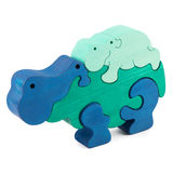 Color wooden hippo toy. Color wooden creative hippo puzzle toy on white stock images