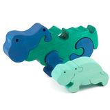 Color wooden hippo toy. Color wooden creative hippo puzzle toy on white royalty free stock photos