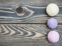 Color woolen clews. For knitting on a wooden background Stock Image