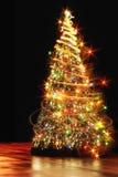 Color xmas tree. Xmas tree (lights) on the black background Royalty Free Stock Photo