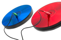 Color your digital world!. Red and blue compact discs with headphone and microphone cords Royalty Free Stock Photo