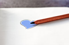 Color your heart. Blue; paper, pencil, heart Royalty Free Stock Photo
