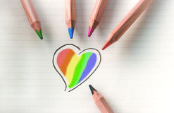 Color your heart - rainbow. Color your love, heart with colorful pencil on paper Stock Photo