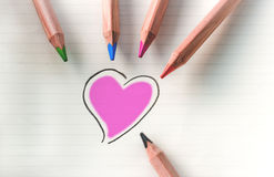 Color your heart - violet. Colored pencils on white background with purple heart Stock Images
