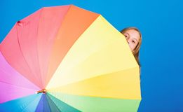 Color your life. Girl cheerful hide behind umbrella. Colorful umbrella accessory. Weather forecast concept. Stay. Positive though rainy day. Brighten up life stock photo