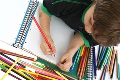 Coloração da criança no assoalho Fotografia de Stock Royalty Free