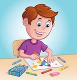 Coloração do menino com pastéis Foto de Stock Royalty Free