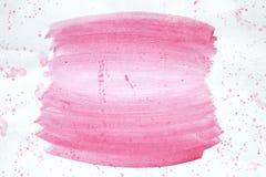 Colora a aquarela cor-de-rosa do respingo pintado à mão no fundo branco Fotos de Stock Royalty Free