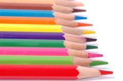 Colora lápis isolados no fim branco do fundo acima Foto de Stock Royalty Free