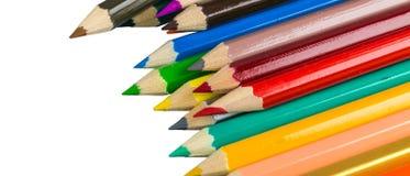 Colora lápis isolados no fim branco do fundo acima Fotos de Stock