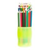 Colora lápis no vidro verde isolado no fundo branco c Foto de Stock Royalty Free