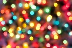 Colora luzes abstratas do Natal fotos de stock royalty free