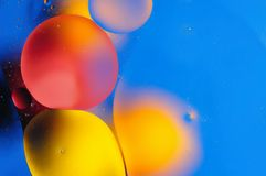 Colora o fundo abstrato baseado em círculos e em ovals vermelhos e amarelos Imagem de Stock Royalty Free