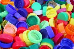 Colora o fundo dos tampões do plástico Imagens de Stock Royalty Free