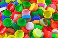 Colora o fundo dos tampões do plástico Foto de Stock