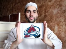Colorado Avalanche ice hockey team logo. Logo of Colorado Avalanche ice hockey team on samsung tablet holded by arab muslim man. The Colorado Avalanche are a stock photo