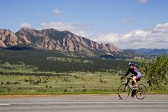Colorado Bicyclist. A woman bikes past the Flatirons during the 2010 Superior Morgul Classic in Superior, CO Royalty Free Stock Photos