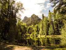 Colorado cimarron reflections. Trees and mountain reflected in pond in the Cimarron Valley of Colorado royalty free stock photography