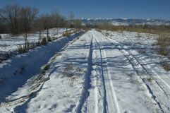Colorado country road. Snow covered country road heading toward the foothills in Colorado Royalty Free Stock Photo