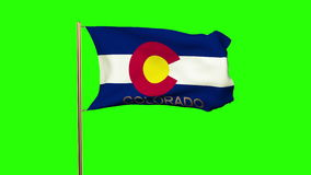Colorado flag with title waving in the wind. Loops sun rises style stock footage