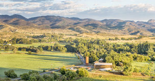 Colorado foothills panorama. Irrigated foothills farmland in sunrise light, Belvue near Fort Collins in northern Colorado stock image