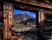 Colorado Ghost Town. Abandoned buildings, of a ghost town, viewed through the window of a building with no roof located in Colorado's Arapaho National Forest Stock Images