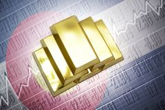 Colorado gold reserves. Shining golden bullions lie on a colorado state flag background Royalty Free Stock Photography
