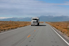 Colorado high way 150. ALAMOSA COUNTY, COLORADO/USA - OCTOBER 2, 2014: A truck is driving on U.S. Highway 150, A straight road ends in to Great sand dunes Stock Photos