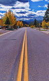 Colorado Highway. Fall day in the mountains of colorado, town highway running into the distant mountains on Fall day Royalty Free Stock Image