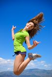 Colorado jump. Teen jump high in Colorado mountains Stock Photography