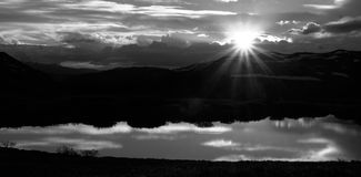 Colorado Landscape with Sunset in Black & White. Hi contract black and white mountain top landscape with sunset and reflecting lake Stock Images