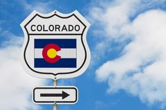Colorado map and state flag on a USA highway road sign. With sky background stock photography