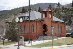 Colorado Mountain City Hall. Idaho Springs, CO, USA - April 19, 2014: Front and side view of a brick city hall building with bell tower at 1711 Miner Street in Royalty Free Stock Images