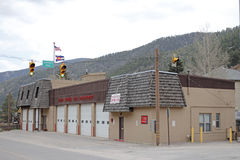 Colorado Mountain Fire Department. Idaho Springs, CO, USA - April 19, 2014: Front and side of modern fire department building with Colorado and American flags stock photo