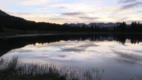 Colorado Mountain Lake Sunrise. A scenic sunrise reflected in a Colorado mountain lake stock footage