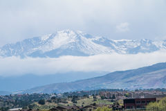 Colorado Mountain in May with a city below Royalty Free Stock Photo