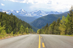 Colorado mountain road, falling rock sign stock images