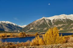 Colorado Mountain on the Twin Lakes. Near Leadville Colorado. Moon is still clear after sunrise in autumn Royalty Free Stock Photo